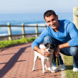Stockfoto: Young man with his pet dog