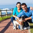Young couple and pet dog — Stockfoto