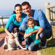 Lovely family and pet dog — Stockfoto