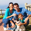 Family at the beach with pet dog — Stock Photo