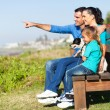 Family sitting on beach bench — Stock Photo