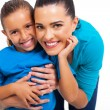 Little girl with her loving mother — Stock Photo