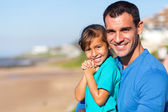 Beautiful and father at beach — Stock Photo
