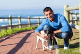 Young man with his pet dog — Stockfoto