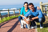 Young couple and pet dog — Stock Photo