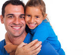 Joyful father giving piggyback ride to his daughter — Stock Photo