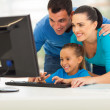 Modern family using computer — Stock Photo