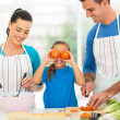 Happy family cooking in kitchen — Photo
