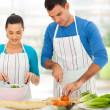 Young couple cooking at home — Stock Photo