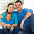 Cute modern family sitting at home — Stock Photo