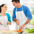 Loving couple chatting while preparing salad — Stock Photo #25521331