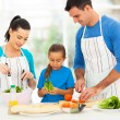 Lovely family preparing food at home — Stok fotoğraf
