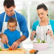 Stock Photo: Father teaching daughter cutting vegetables