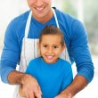Stock Photo: Happy father daughter cooking together