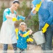 Stock Photo: Happy family cleaning home window