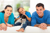 Loving family lying on bed — Stock Photo