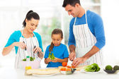 Lovely family preparing food at home — ストック写真