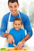 Happy father daughter cooking together — Stockfoto