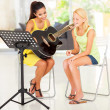 Young preteen girl having guitar lesson — Stock Photo