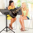 Young preteen girl having guitar lesson — Stock Photo #26285845