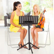 Preteen girl having violin lesson — Stock Photo