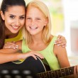 Music tutor and preteen girl with a guitar — Stock Photo