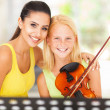 Music teacher with young student — Stock Photo