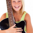 Beautiful young preteen girl holding a guitar — Stock Photo