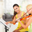Preteen girl play violin under teacher's instructions — Stock Photo