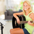 Preteen girl practicing guitar — Stock Photo