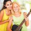Stock Photo: Preteen girl with her music teacher