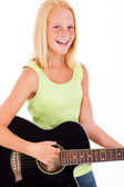 Pre teen girl playing a guitar — Stock Photo