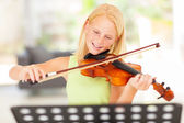 Preteen girl practicing violin at home — Stock Photo