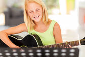 Young pre teen musician playing guitar — Stock Photo