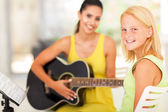 Pre teen girl in music class — Stock Photo