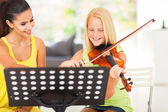 Pre teen girl enjoying her violin lesson — Stock Photo