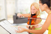 Preteen girl in music class — Stock Photo