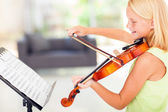 Talented preteen girl playing violin — Stock Photo