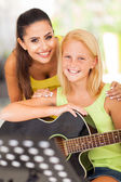Friendly teacher with her music learner — Stock Photo