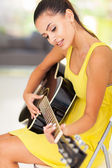 Beautiful woman playing guitar — Stock Photo