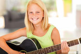 Pre teen girl practicing guitar at home — Stock Photo