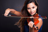 Attractive woman playing violin — Stock Photo