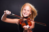 Cheerful preteen girl playing violin — Stock Photo