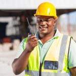 Builder talking on radio — Stock Photo #26343381