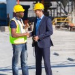 Stock Photo: Construction manager and worker handshake