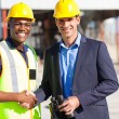 Industrial manager and worker outdoors - Photo