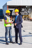 Construction manager and worker handshake — Stock Photo