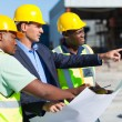 Architect and construction workers — Stockfoto