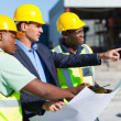 Stock Photo: Architect and construction workers