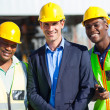 Construction businessman and workers — Stock Photo